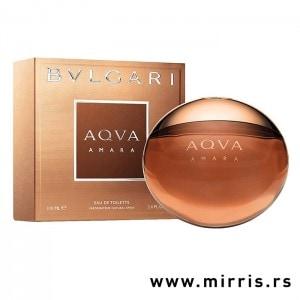 Okrugla bočica parfema Bvlgari Aqva Amara pored originalne kutije