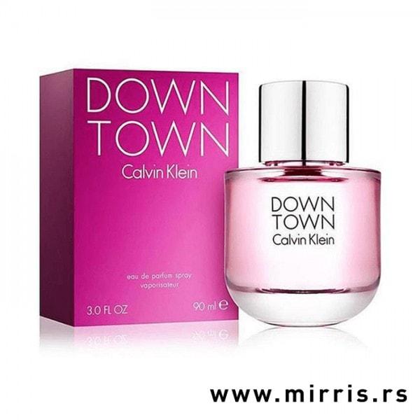 Kutija ljubičaste boje i bočica originalnog parfema Calvin Klein Downtown