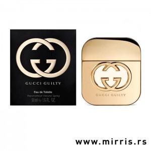 Boca parfema Gucci Guilty zlatne boje pored originalne kutije