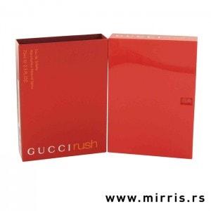 Boca originalnog parfema Gucci Rush pored crvene kutije