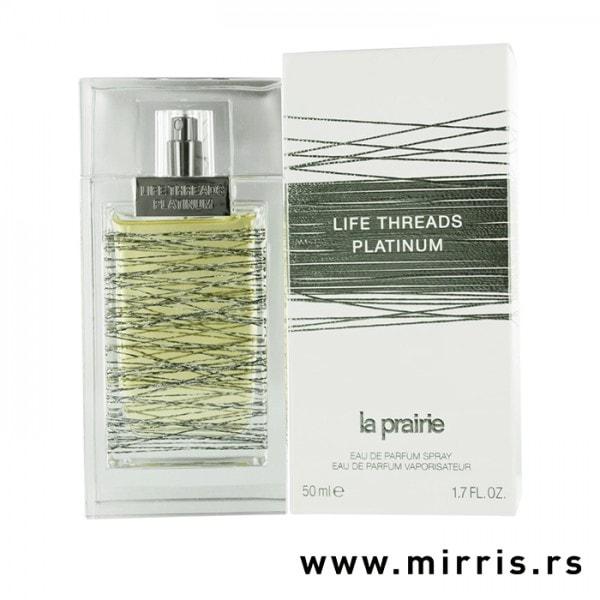 Boca originalnog parfema La Prairie Life Threads Platinum pored kutije