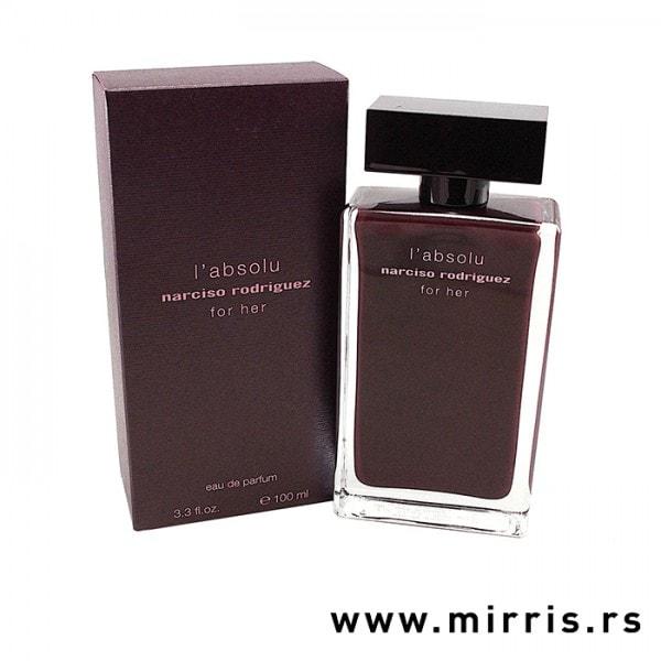 Boca originalnog parfema Narciso Rodriguez For Her L'Absolu pored ljubičaste kutije