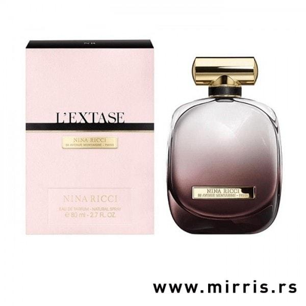 Boca originalnog parfema Nina Ricci L'extase pored kutije roze boje