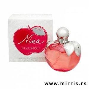 Crvena bočica parfema Nina Ricci Nina u obliku jabuke i originalna kutija