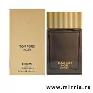 Kutija zlatne boje i bočica parfema Tom Ford Noir Extreme