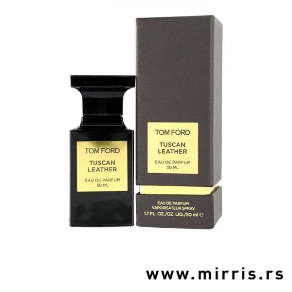 Bočica originalnog parfema Tom Ford Tuscan Leather pored smeđe kutije