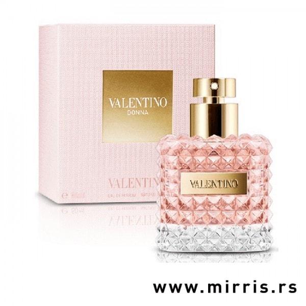 Roze boca parfema Valentino Donna pored kutije roze boje