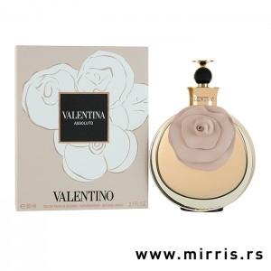 Bočica originalnog mirisa Valentino Valentina Assoluto pored roze kutije