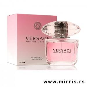 Roze bočica originalnog parfema i roze kutija