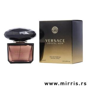Boca originalnog parfema Versace Crystal Noir pored crne kutije
