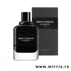 Crna bočica parfema Givenchy Gentleman pored kutije sive boje