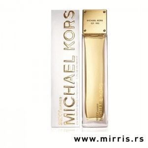 Bočica parfema Michael Kors Sexy Amber pored originalne kutije