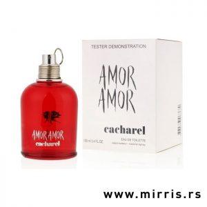 Crvena bočica parfema Cacharel Amor Amor pored bele kutije