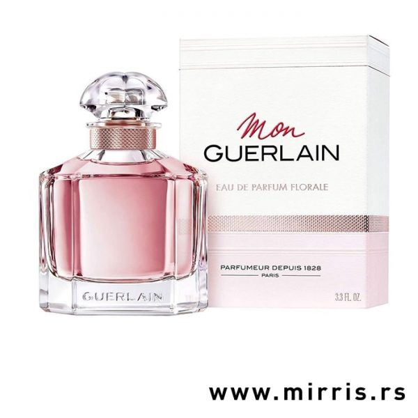 Roza bočica parfema Guerlain Mon Guerlain Florale pored originalne kutije